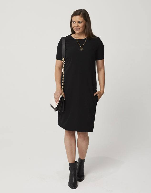 One P Sheath Dress in Black. This dress follows the curves of your body giving you a beautiful silhouette without being restrictive and uncomfortable.