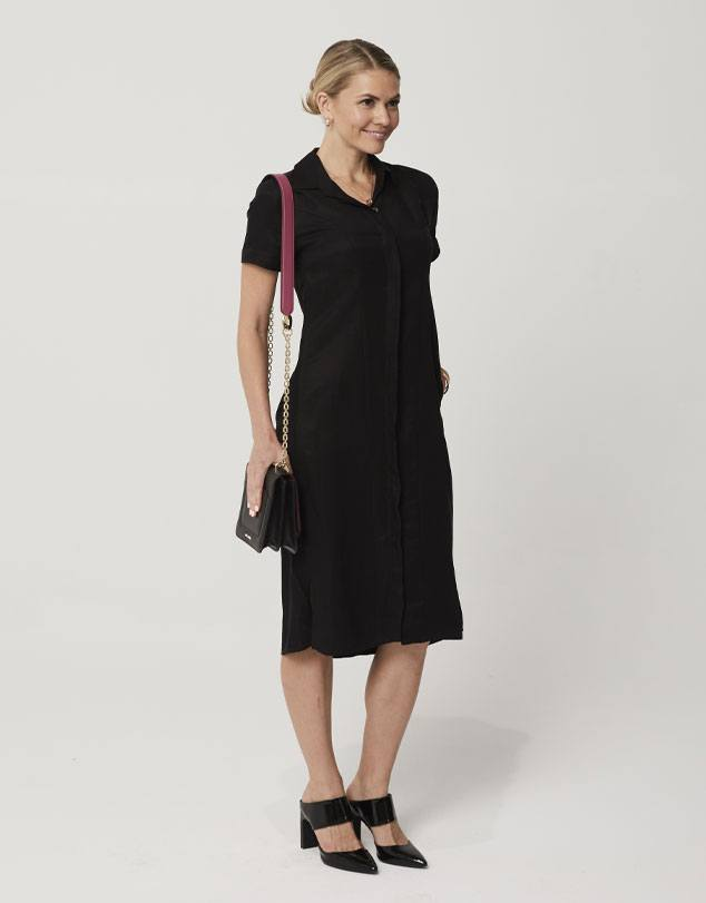 One P Shirt Dress in Black. This dress has been designed to shape your body in the right places.