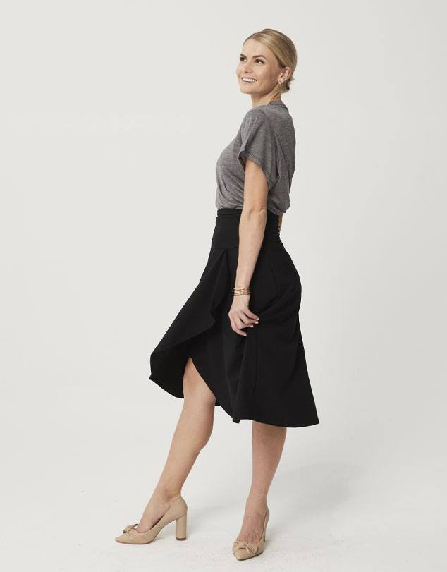 One P Fold Skirt in Black. This skirt has been shaped with a yoke waist and a flowing drape from the hips.