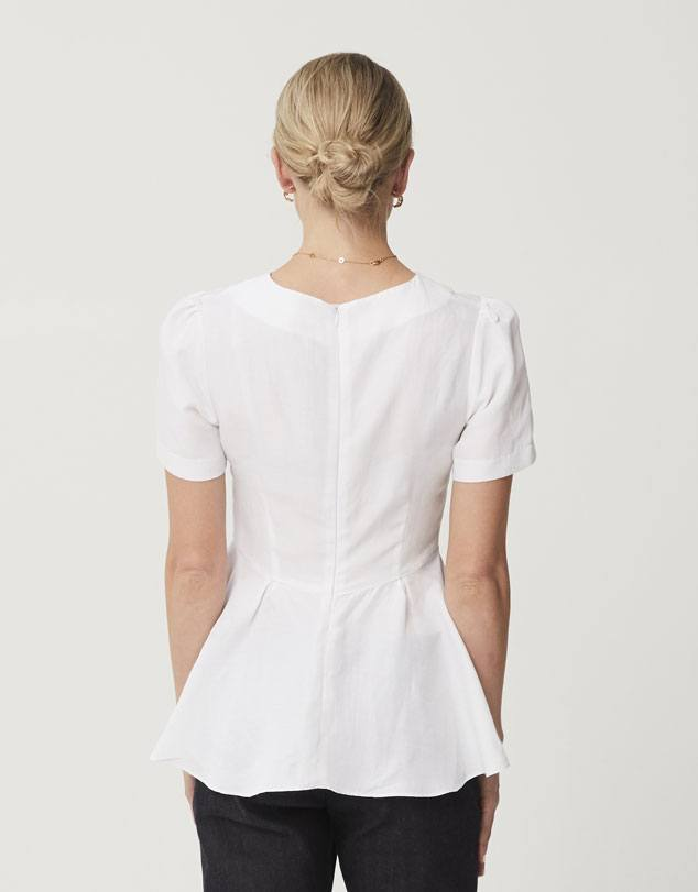One P Peplum Top in White. Designed with a small gather at the shoulder for a little touch of feminity.
